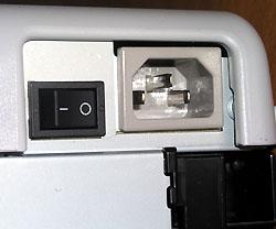 Кнопку включения принтера не надо долго искать